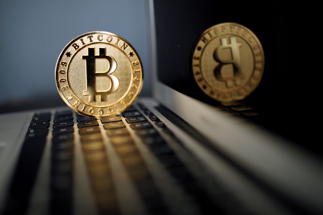 FILE PHOTO: A Bitcoin (virtual currency) coin is seen in an illustration picture taken at La Maison du Bitcoin in Paris - NARCH/NARCH30