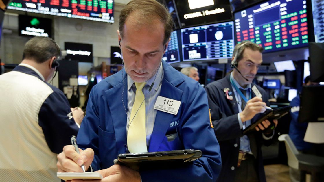 Mark Puetzer - Trader Mark Puetzer, center, works on the floor of the New York Stock Exchange, Thursday, Feb. 22, 2018. Stocks are opening higher on Wall Street following a late sell-off in the market a day earlier. (AP Photo/Richard Drew)
