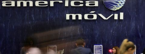FILE PHOTO: The logo of America Movil is pictured on the wall of a reception area in the company