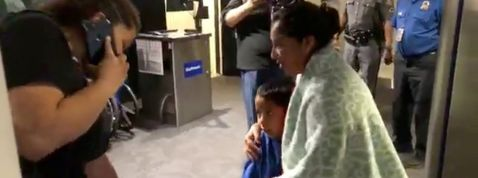 A migrant mother and her son are reunited after immigrant separation, in Baltimore-Washington International Airport - 3TP MNDTY NARCH/NARCH30