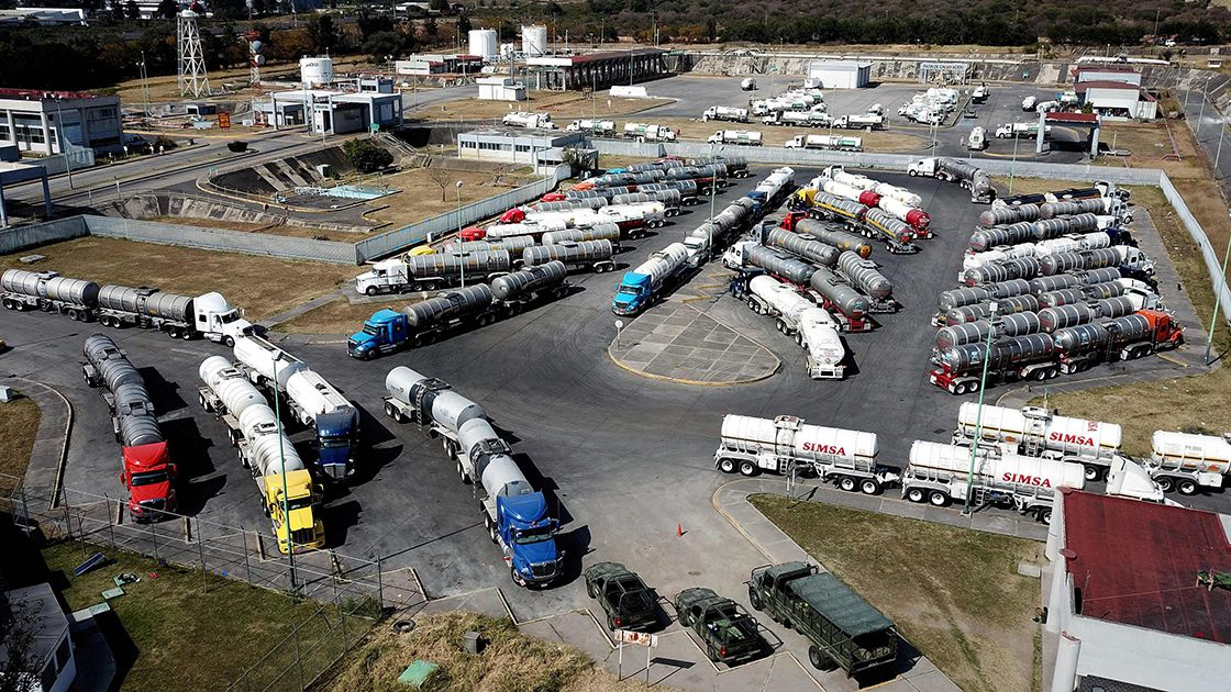 Tanker trucks wait to load gasoline to distribute to Pemex gas stations in El Salto, Jalisco state, due to the shortage of fuel in states such as Hidalgo, Jalisco, Michoacan, Guanajuato, Mexico and Queretaro, Mexico on January 7, 2019. - President Andres Manuel Lopez Obrador recently announced a joint plan with state-run oil company Pemex to tackle fuel theft from pipelines and within the company. (Photo by ULISES RUIZ / AFP)