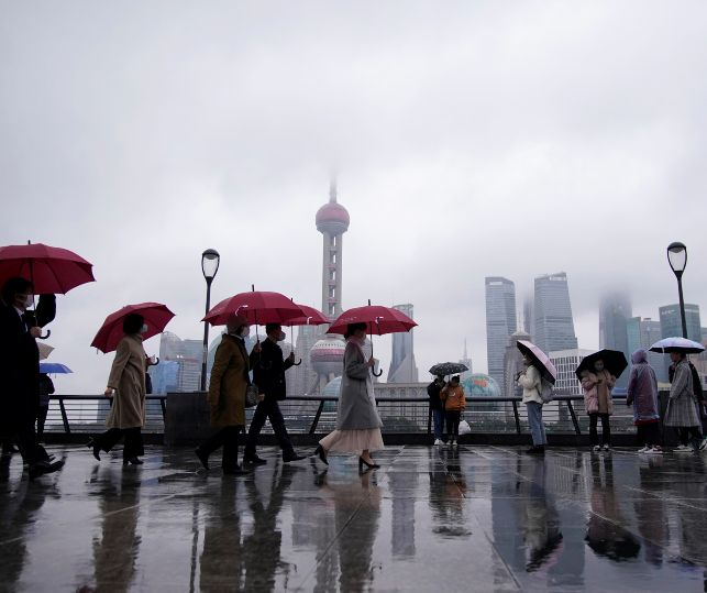 People wearing masks are seen at the Bund in Shanghai