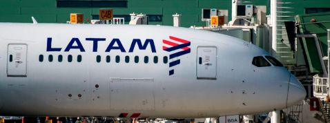 A Latam airlines plane sits on the tarmac at Santiago International Airport, in Santiago on May 26,2020, during the new coronavirus, COVID-19, pandemic. - Latin America